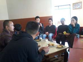 Monthly YI meeting at YDF cafeteria.