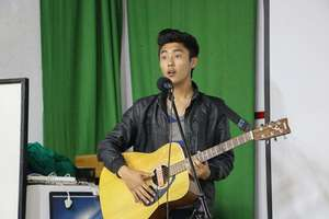 Young and talented singer during Open Mic Night