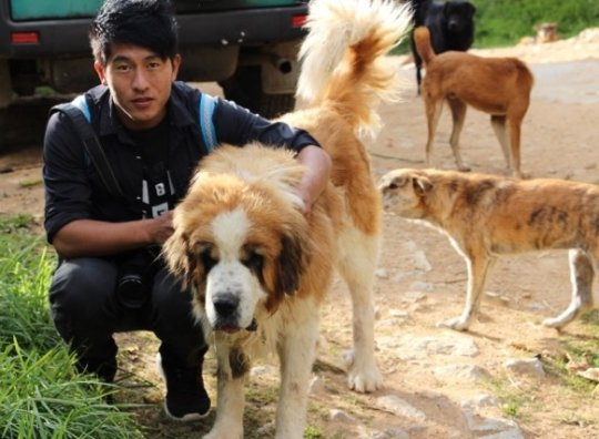 A participant at the animal centre during shooting