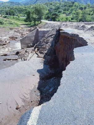 Flood damage to main road
