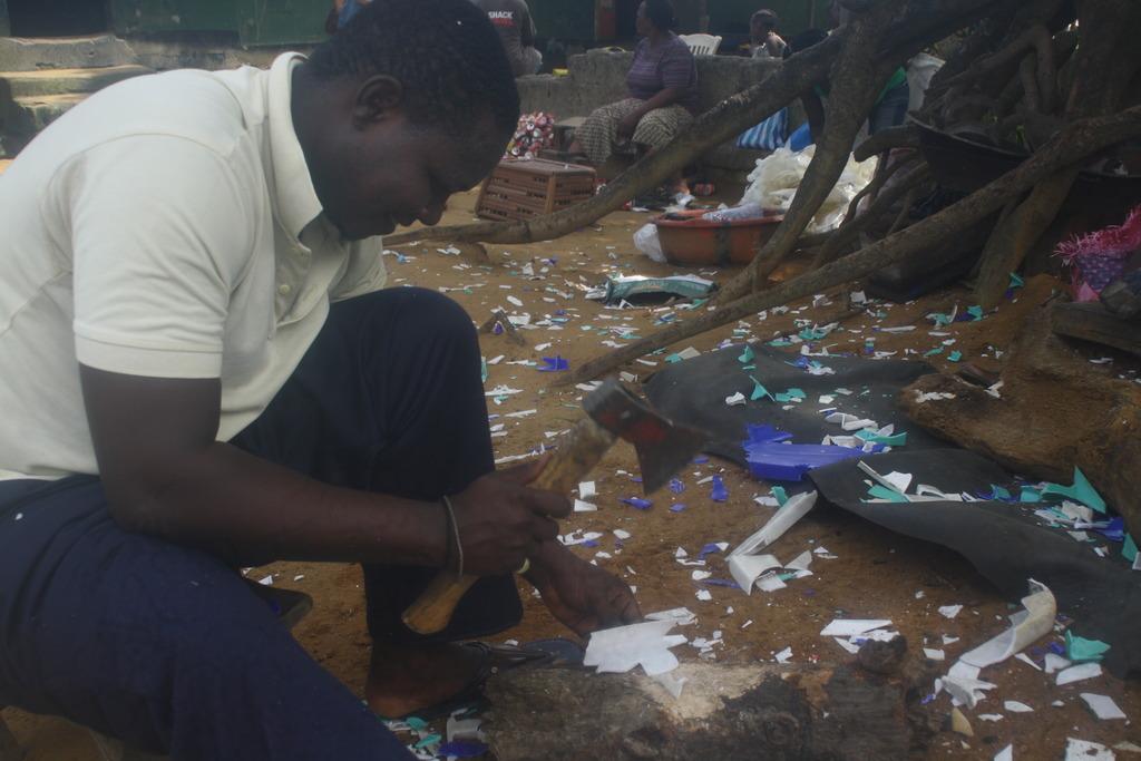 Worker Abraham Ivy breaks down plastic scraps.