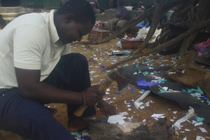 Worker Abraham Ivy breaks down plastic scraps.