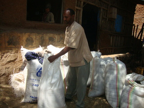 Solomon carrying bags of rice