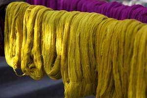 A weaver's colourful work is hanging out to dry