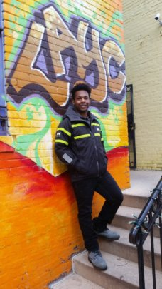 Marcus, after living in safe housing due to LAYC!