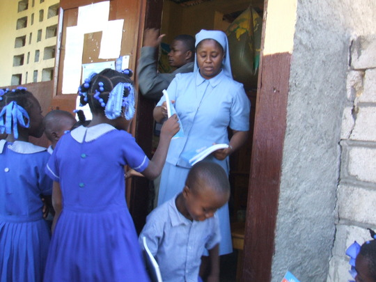 School Principal Sr Christiane Distributing Books