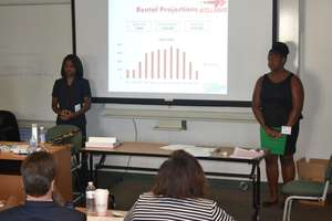 Baltimore students presenting their business
