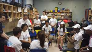 Citi volunteers and business mentors with students