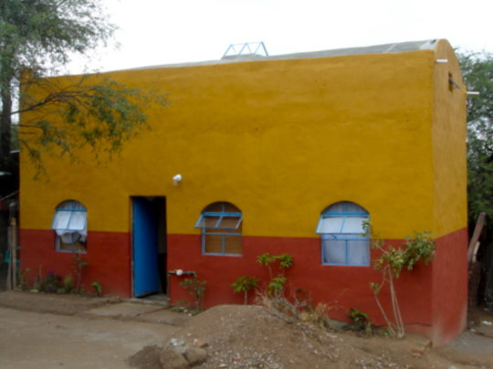Casita with exterior paint and landscaping.