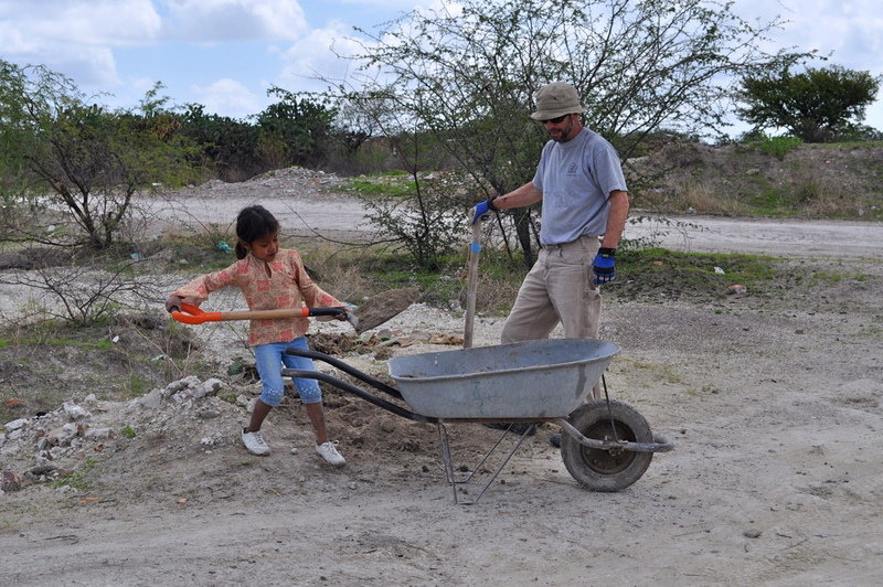A family member shows a volunteer how it