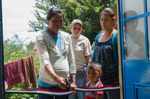 Maria and her family receiving her new home.