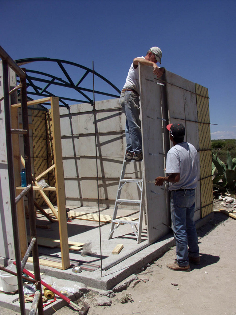 Volunteers constructing a new house