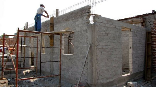 The walls are up & made ready for the roof.