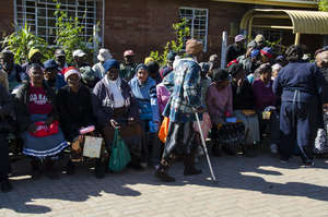 Beneficiaries of the project queing at the centre