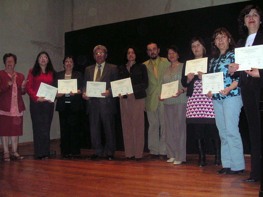 Photo-- Mothers receiving their diplomas