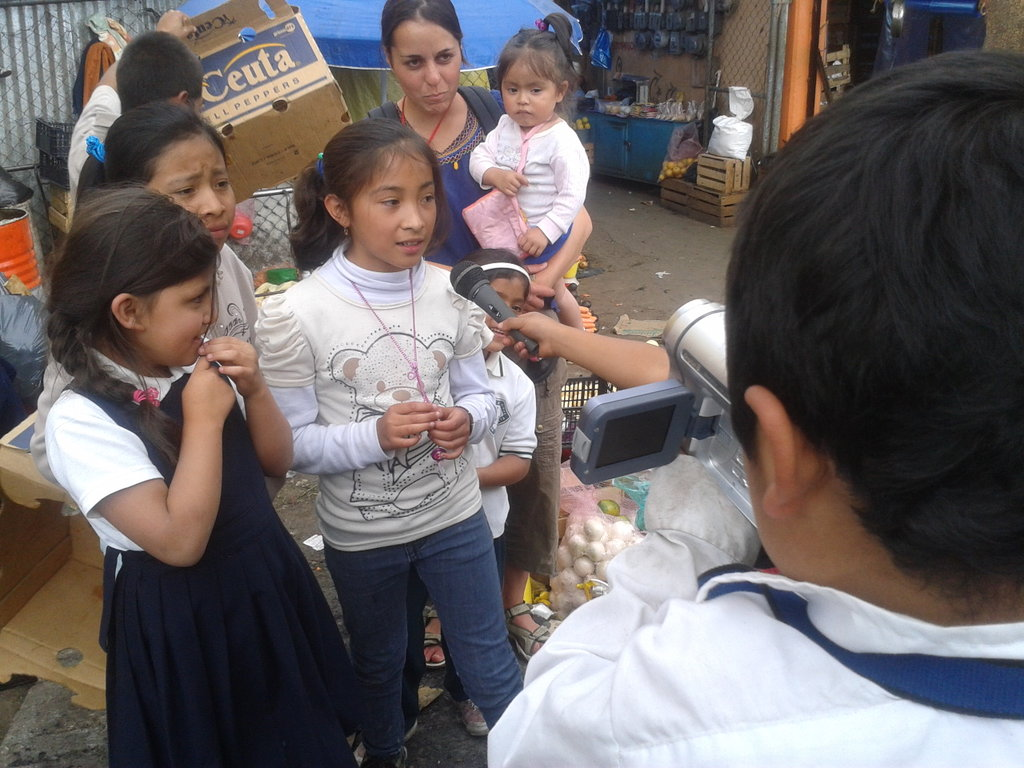 Children making a video about their life and work