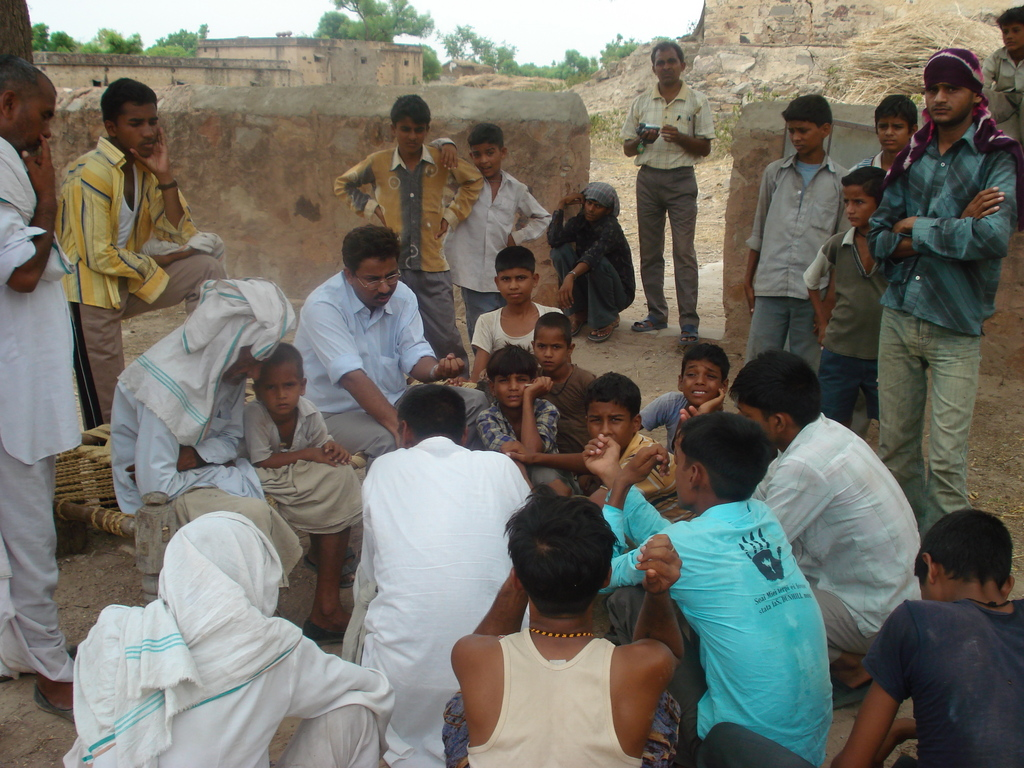 Photo-- Aman Singh, project leader, talks to community about tre