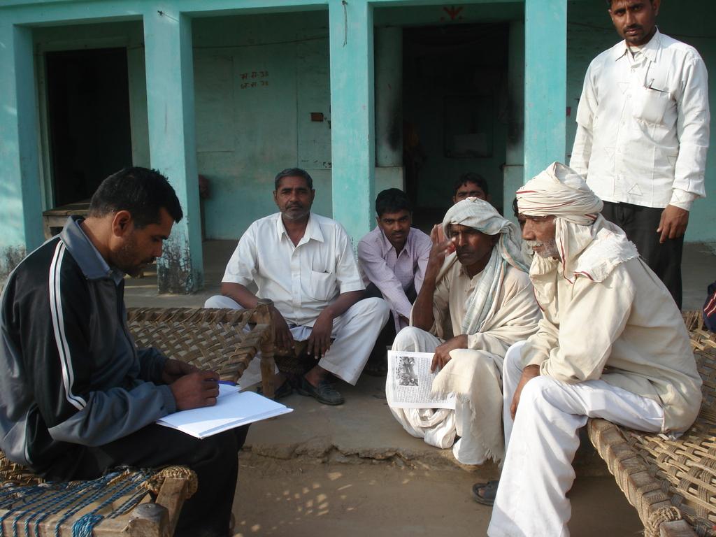 Documenting Orans_KRAPAVIS staff among community