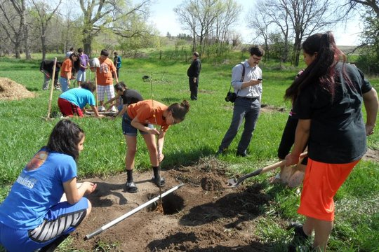 Planting orchard at Red Cloud Indian School