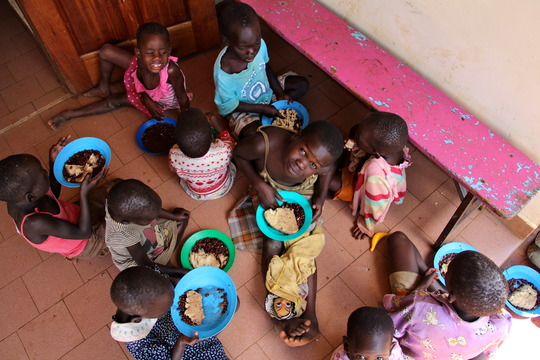 Children sharing a meal at St. Jude's