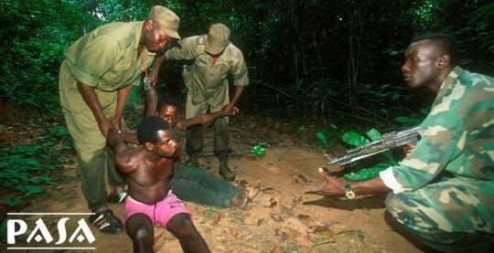 A wildlife trafficker arrested by a forest patrol