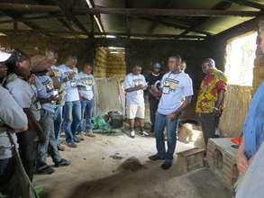 village leaders demonstrate efficient cookstoves