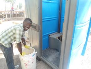 Servicing SOIL's toilets in Port-au-Prince