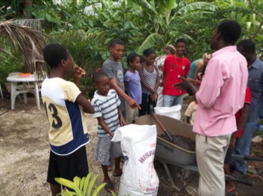 Leading an EcoSan education class at the SOIL farm