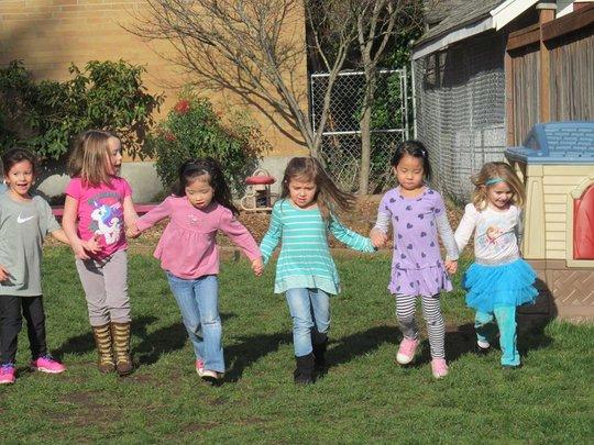 L&T children lending each other helping hands