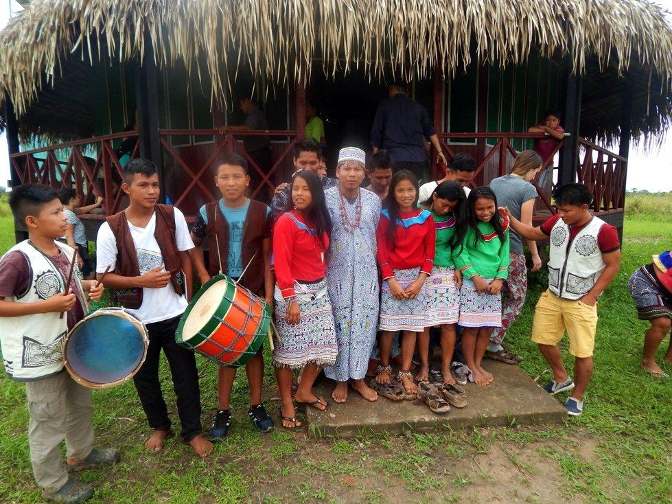 Youth outside traditional maloka in Santa Clara