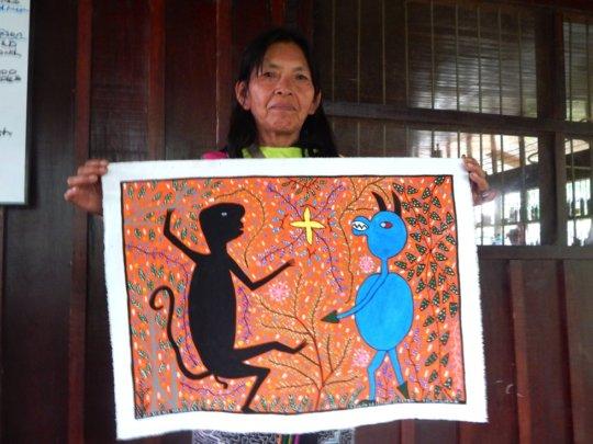 Lastenia holding painting