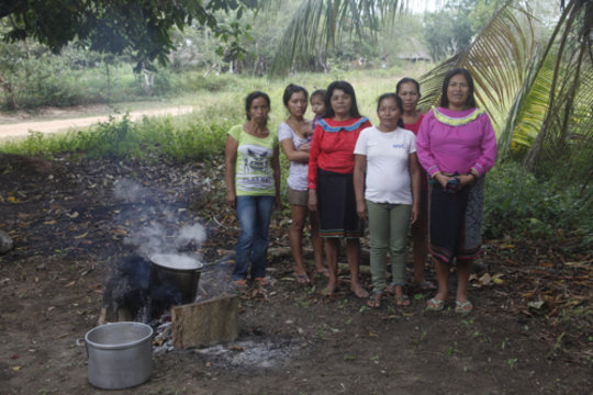 Group of mothers cooking
