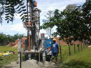 Drilling company installing a borehole at Chiedza