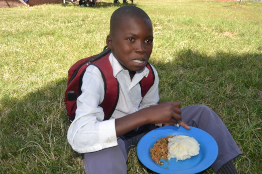 child enjoying his hot meal during good times..