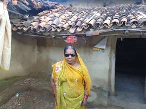 Tetri standing in front of her house