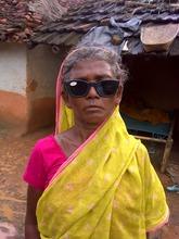 Kajri in front of her home