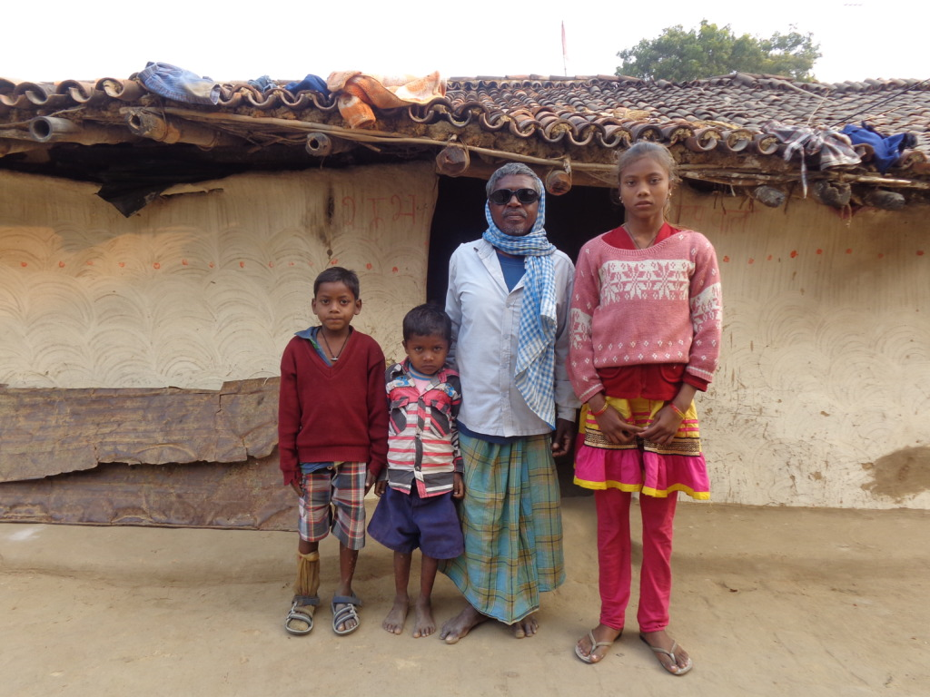 Bhado with his children infront of his house