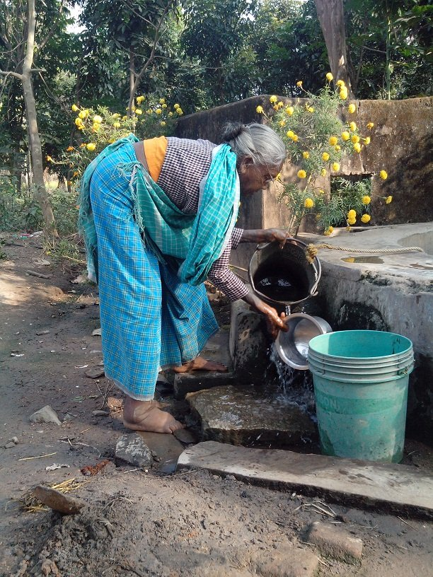 Saroni Soren taking out water from the well