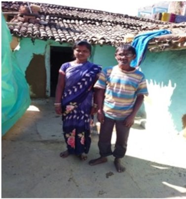 Mahendra infront of his home