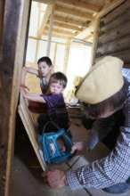 A volunteer working with his children