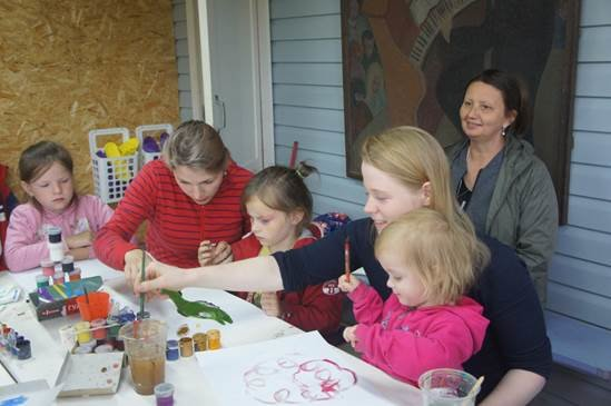 Tania and daughter painting together happily