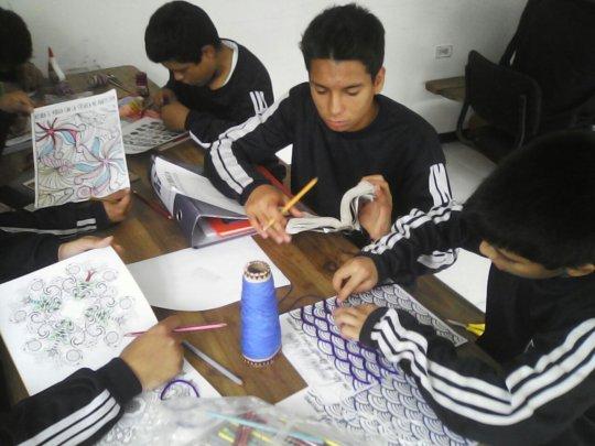 Creating their bracelet design.
