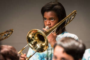 A trombone player plays with diligence!