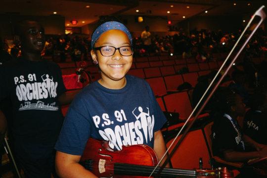 An orchestra player cheers! Credit: Daniel Pagan