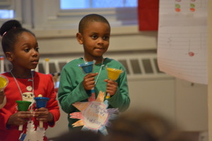 Students practice rhythms with hand bells.