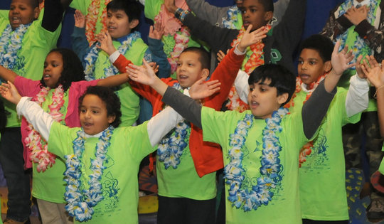 Students sing in an elementary school chorus.
