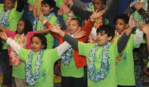Students sing in an elementary school chorus.