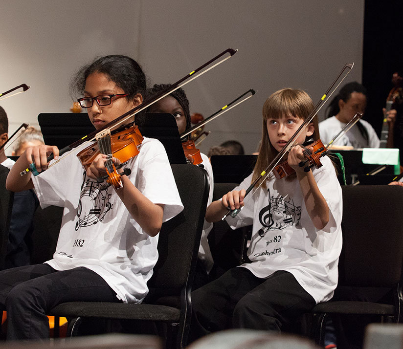 Orchestra students play with dedication!