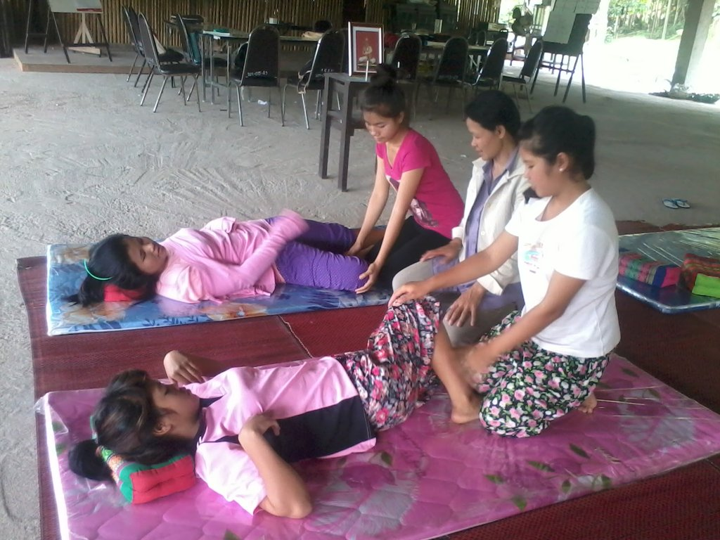 Kru Lek teaching the arts of massage