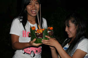 Putting the finishing touches to a krathong
